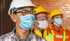 [Construction Teamwork ] Team of construction engineers and three architects are ready to wear medical masks. Corona or Covid-19 wear masks during the design of construction.